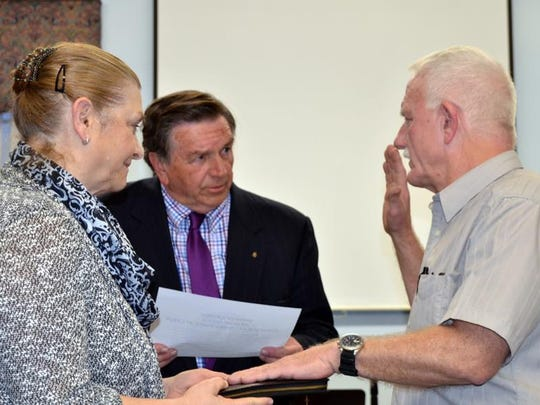 Alan Schweitzer, right, an Ocean City and Laurel firefighter and paramedic, is sworn in as a Laurel councilmember on Monday, April 17. Schweitzer died after a motorcycle crash on Thursday, April 20.