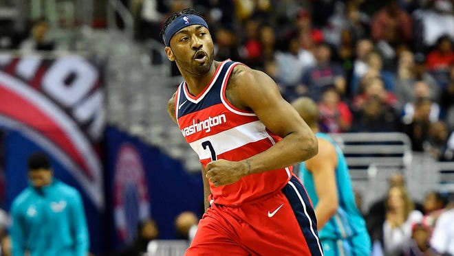 John Wall had 15 points and 14 assists in his first game in two months