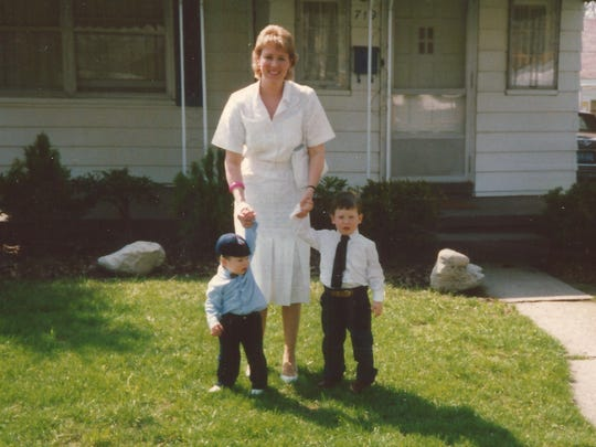 Teresa Di Pietro stands in front of her family's Michigan home with her sons Robert, 2, (left) and Donald, 3, dressed up to attend Easter church service in the spring of 1988. Across the country in Texas, just a few weeks before, Malcolm Guy McBurnett was arrested on his first DWI charge.     Center, Teresa with her sons, left, Robert, 2 and Donald, 3, in front of their home in a suburb of Michigan, dressed up to attend Easter Church Service around the time Malcolm Guy McBurnett received his first DWI arrest in March 1988.