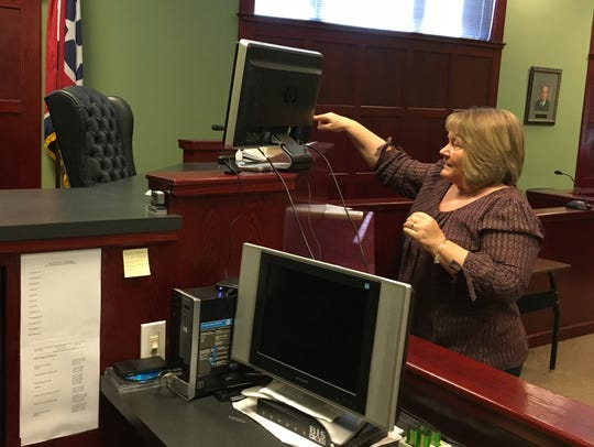 Houston County Court Clerk Donna Vincent sets up a