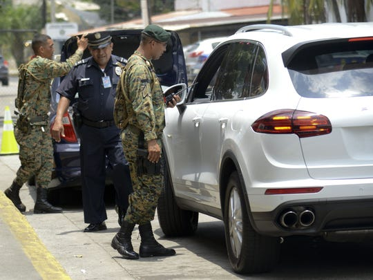 Panamanian Army soldiers check drivers near the Atlapa