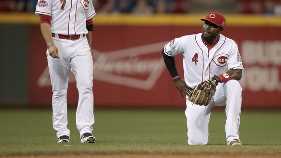 Brandon Phillips looks frustrated after the Cubs scored on an Addison Russell double in the top of the ninth inning.