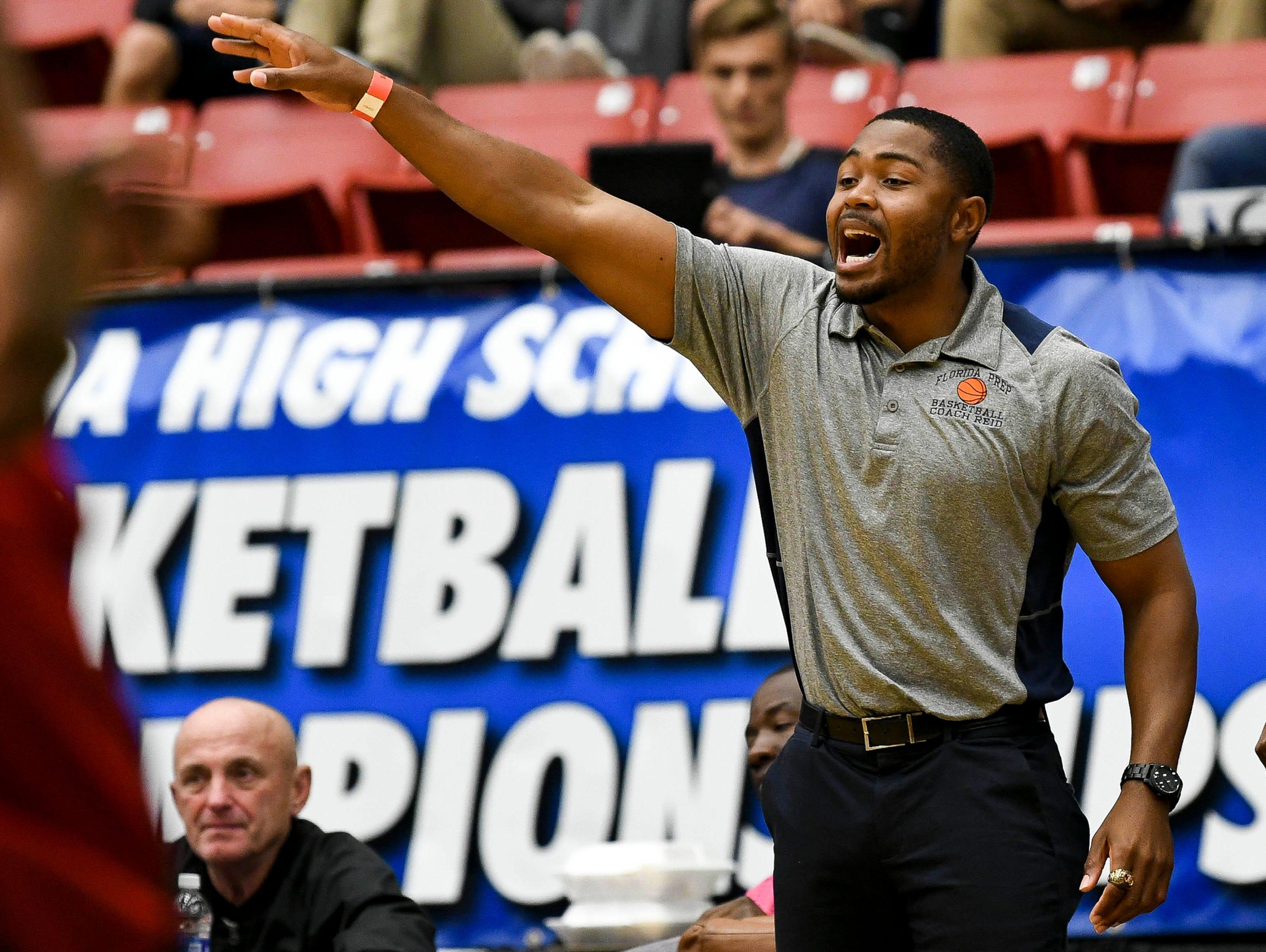 Florida Prep basketball head coach Julius Reid directs his team during Tuesday's Class 2A basketball semifinal.