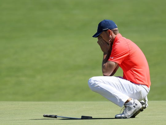 Jordan Spieth of the United States reacts to a misesd