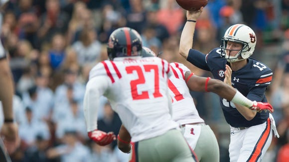 Auburn Tigers quarterback Sean White (13) throws a pass during the NCAA football game between Auburn and Ole Miss on Saturday, Oct. 31, 2015, at Jordan-Hare Stadium in Auburn, Ala.