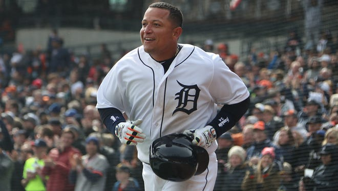 Detroit Tigers first baseman Miguel Cabrera is all smiles as he crosses home plate in the 7th inning as the Detroit Tigers take on the Pittsburgh Pirates at Comerica Park for Opening Day in Detroit Friday March 30, 2018.