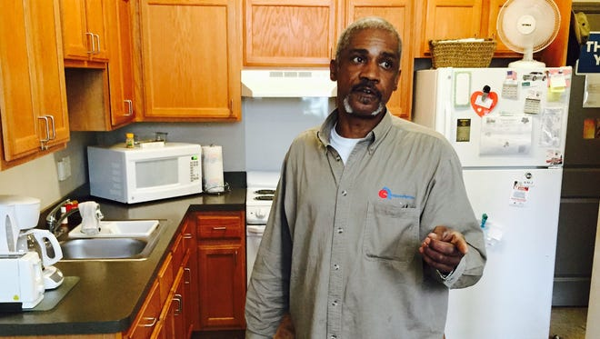 Army veteran Marcus Cobb, 60, shows off his apartment on Monday, April 20, 2015, at Piquette Square, an apartment building in Detroit that houses about 150 formerly homeless veterans.