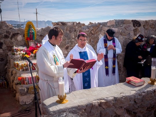"""Bishop Oscar Cantú performs the Catholic Mass on the top of Tortugas """"A"""" Mountain on Friday morning. Hundreds of people converged on the mountain as part of Tortugas Pueblo's three day Our Lady of Guadalupe Fiesta."""