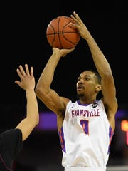 University of Evansville's Ryan Taylor (0) takes a jump shot as the University's of Evansville Purple Aces play the Missouri State Bears at the Ford Center Wednesday, January 10, 2018.