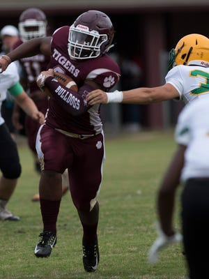 Pensacola High School's Abram Smiley, (No.8) suits up in a Tigers uniform and takes on his old teammates during the spring season football game against Catholic High Wednesday, May 16, 2018.
