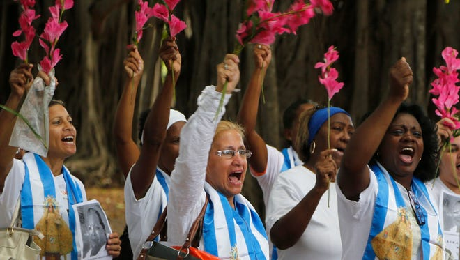 Members of the Cuban dissident group Ladies in White participate in a demonstration in Havana, Cuba, on Dec. 28, 2014. They have faced political persecution in the past, but Cuba is now releasing political prisoners as part of a historic deal to normalize diplomatic relations with the U.S.