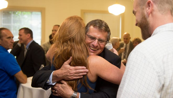 U.S. Marshal Jimmy Fowler is greeted by Erin and Ben Slocum during a reception at the Howard Baker Jr. courthouse on Thursday, June 22, 2017. Fowler is stepping down as Marshal of the Eastern District of Tennessee.