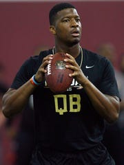 Jameis Winston looks for a receiver during Florida