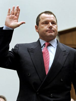 In this Feb. 13, 2008, file photo former New York Yankees baseball pitcher Roger Clemens is sworn-in on Capitol Hill in Washington prior to testifying before the House Oversight, and Government Reform committee hearing on drug use in baseball. Clemens got a significant bump in the number of Hall of Fame votes he received this year.