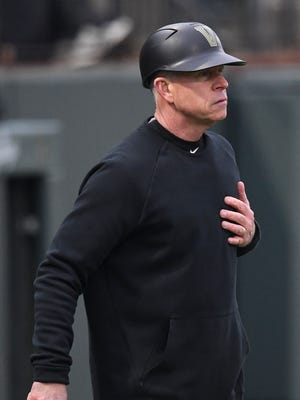 Vanderbilt head coach Tim Corbin gives a sign to his players during the game against Duke at Hawkins Field Friday, Feb. 16, 2018 in Nashville, Tenn.