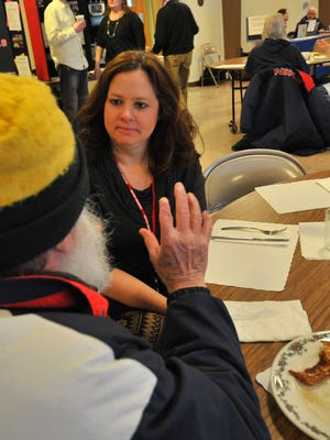 Corine Laub of The Women's Community chats with a person, who asked not to be identified, during a community breakfast Thursday at First United Methodist Church in Wausau.