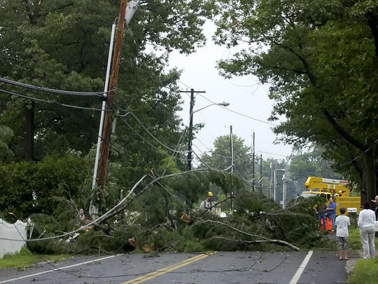 A 2006 photo showing downed trees and power lines in Colchester.