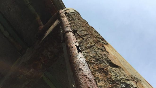 Deteriorating concrete on an overpass on Route 390 over a Gates road last spring.
