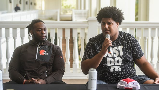 Cleveland Browns offensive tackle Zach Banner, right, with teammate, defensive lineman Larry Ogunjobi, during a press conference at the Sheraton Laguna Guam Resort in Tamuning on  Jan. 24, 2018. Banner and Ogunjobi are on island to hold free football camps and clinics until Jan. 31 at Guam High School.