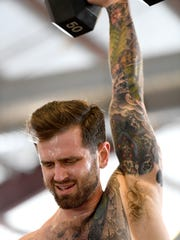 Michael Belliveau does a snatch, lifting a 50-pound