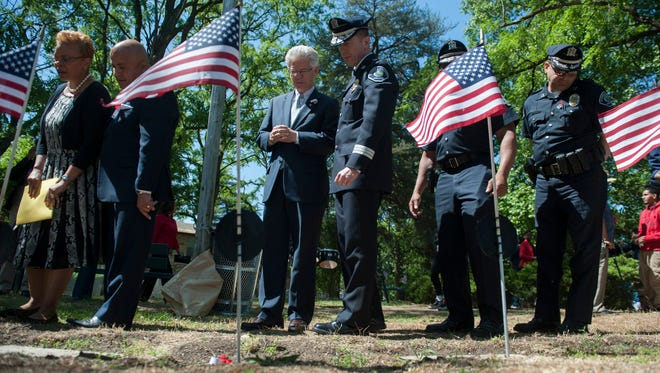(From left) Camden Mayor Dana Redd, City Council President Frank Moran, former state assemblyman Jack Conners and Camden County Police Chief Scott Thomson tour Johnson Cemetery Memorial Park in Camden on Friday.