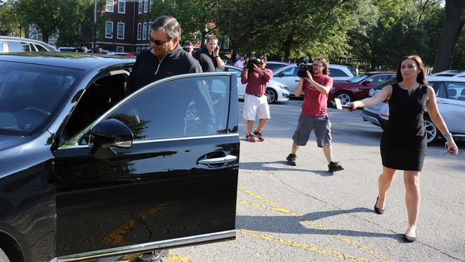 UofL Athletic Director Tom Jurich leaves Grawemeyer Hall after having a meeting with interim president Greg Postel.  Jurich left the building less than 10 minutes later.