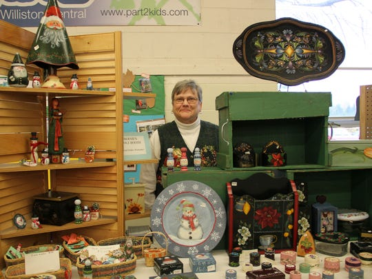 Bernadette Ferenc of Williston poses with her holiday creations in Williston.