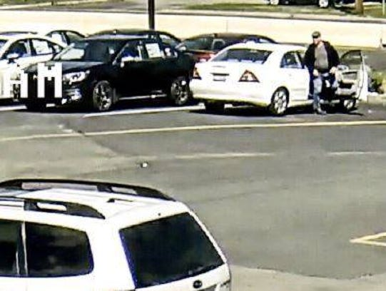 Police suspect the man getting out of this car stole