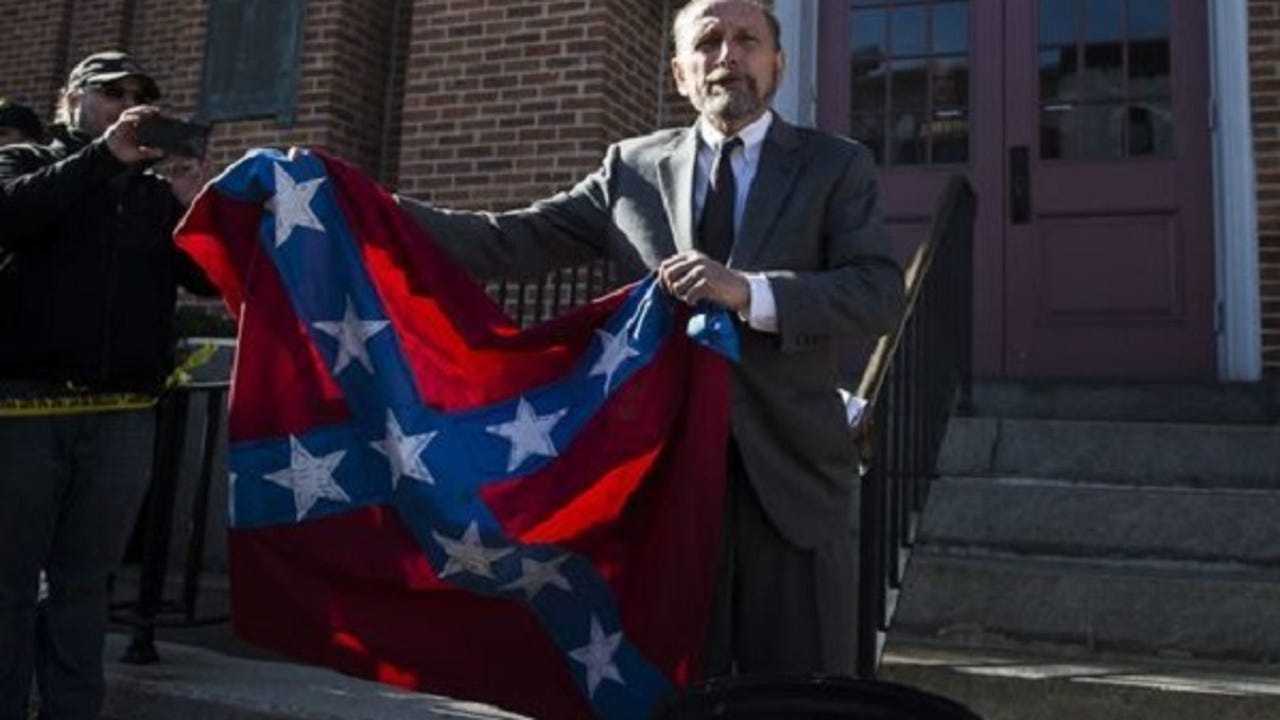 Central Pa. activist Gene Stilp burned a combined Confederate-Nazi flag to both applause and jeers in Gettysburg on Nov. 17.