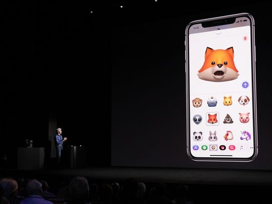 Apple's software chief on stage demonstrating the face-tracking capabilities of the new iPhone X.