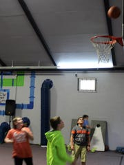 Students in the Fuse program shoot hoops in the Erin