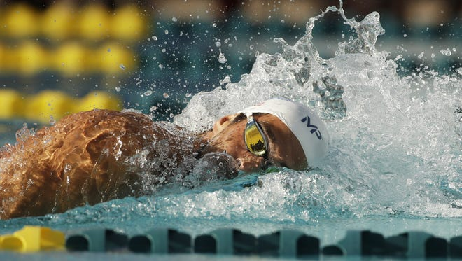 Michael Phelps wins the Men 200 LC Meter freestyle B-final at the Arena Pro Swim Series at Skyline Aquatic Center in Mesa, Ariz., on Thursday, April 14, 2016.