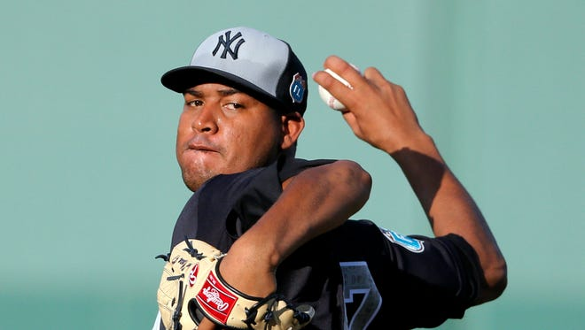 New York Yankees starting pitcher Ivan Nova throws a warm up pitch in the first inning of a spring training baseball game against the Boston Red Sox on Tuesday, March 15, 2016, in Fort Myers, Fla.