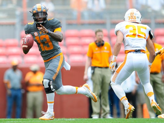 Tennessee quarterback Sheriron Jones (13)  looks to pass as running back Taeler Dowdy (35) provides protection during the Orange & White Game at Neyland Stadium in Knoxville, Tennessee on Saturday, April 22, 2017.
