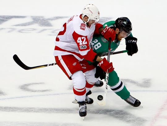 Red Wings forward Martin Frk battle for the puck against