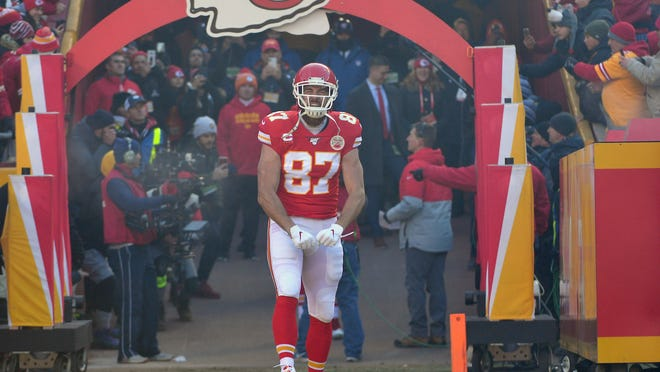 Jan 19, 2020; Kansas City, Missouri, USA;  Kansas City Chiefs tight end Travis Kelce (87) is introduced before the AFC Championship Game against the Tennessee Titans at Arrowhead Stadium. Mandatory Credit: Denny Medley-USA TODAY Sports