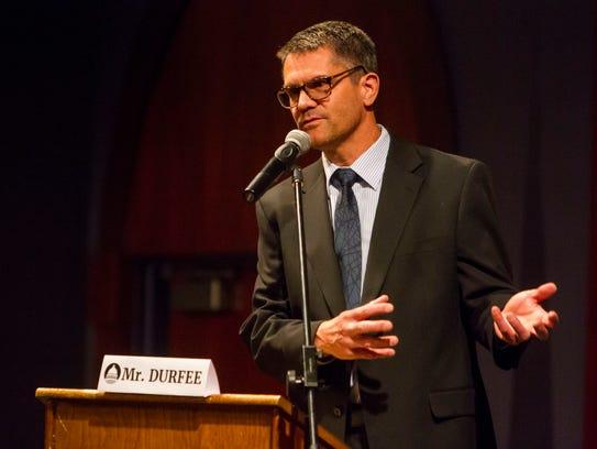 Mayoral candidate Ryan Durfee speaks during a debate