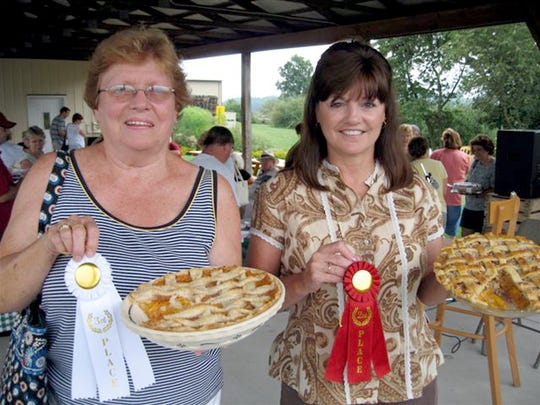 Bonnie Billet, right, pictured after winning a baking competition at Brown's Orchard in 2009. Bonnie recently won best Whoopie Pie at the Pennsylvania Farm Show.