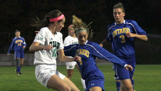 Ontario's Kait Schuster keeps the ball away from Clear Fork's Lauren Callen at Clear Fork High School on Tuesday night.
