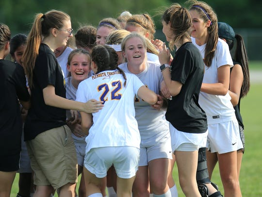 The Plymouth Christian girls soccer team is a happy