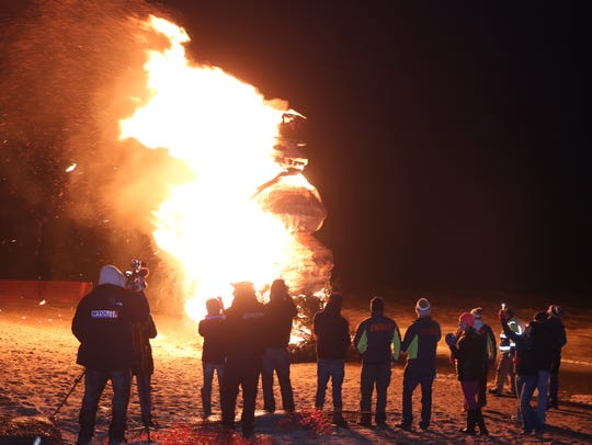 "Last year, ""Floyd"" burned for about two minutes, flames stretching from his base at the sand to his top hat 30 feet up at the 2018 Burning Snowman Festival."