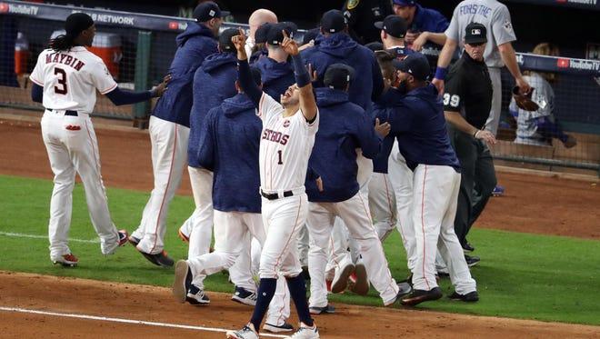 Astros shortstop Carlos Correa celebrated after Sunday's 13-12 victory.