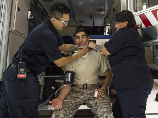 Hector Maldonado, a 49th Medical Operations Squadron emergency medical technician-Intermediate, and Annette Dunlap, the 49th MDOS area project manager and a paramedic, perform an emergency response simulation on a volunteer for National Emergency Medical Services week at Holloman Air Force Base, N.M. on May 18, 2017. National EMS week was established in 1974, as a means to honor EMS practitioners and their contributions to families and communities across the United States. Holloman's EMS practitioners work 24-hour shifts. The most basic function of their job involves responding to 911 and flight line emergencies.