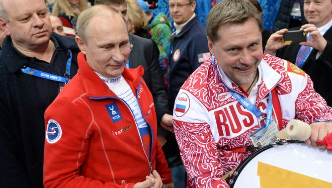 Russian president Vladimir Putin, left, has been out front for his country in Sochi,
