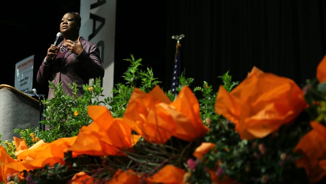 Featured speaker Sybrina Fulton speaks at Thursday's 23rd annual YWCA Women's Luncheon at the El Paso convention center.