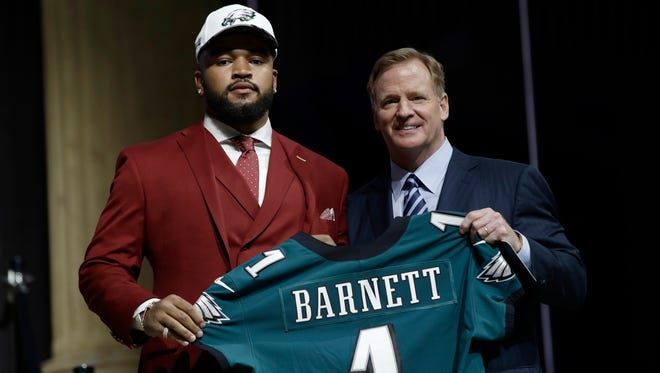 Tennessee's Derek Barnett, left, poses with NFL commissioner Roger Goodell after being selected No. 14 overall by the Philadelphia Eagles during the first round of the 2017 NFL football draft, Thursday, April 27, 2017, in Philadelphia.