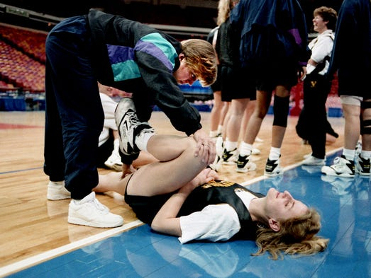 Trainer Anne Louise McDonald, left, helps Vanderbilt's Julie Powell loosen up during their practice session at the Omni in Atlanta April 2, 1993. The No. 1 ranked Commodores, making their first trip to the NCAA Final Four, face No. 5 ranked Texas Tech in the semifinal game.