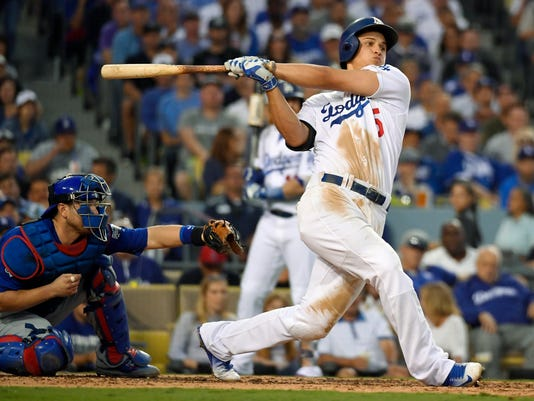 ,FILE - In this Oct. 18, 2016, file photo, Los Angeles Dodgers' Corey Seager hits an RBI single during the third inning of Game 3 of the National League baseball championship series against the Chicago Cubs in Los Angeles. General managers are expecting power from their shortstops, and batters like Carlos Correa, Addison Russell and Corey Seager are providing an unprecedented supply. Shortstops hit more homers than ever in 2016, signaling a potential end to the days of the speedy, slap-hitting middle infielder. (AP Photo/Mark J. Terrill, File)