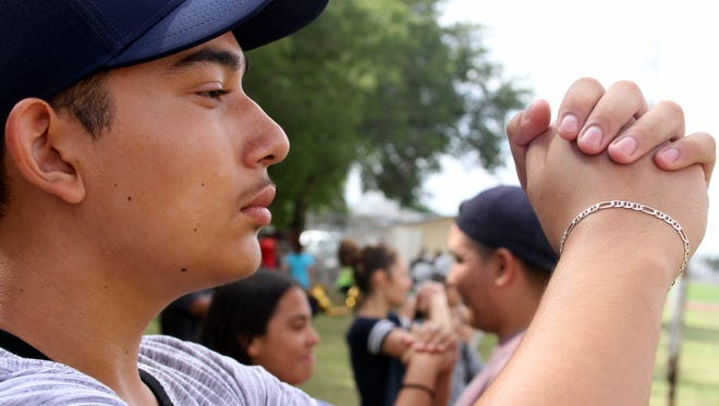 Sophomore Alexis Mejia works on his alignment during summer band camp at Deming High School.