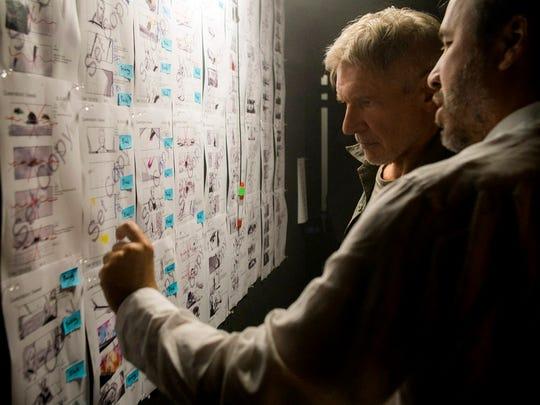 Director Denis Villeneuve (far right) goes over storyboards